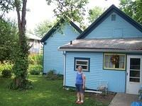 Barb stands in front of the original back of the house